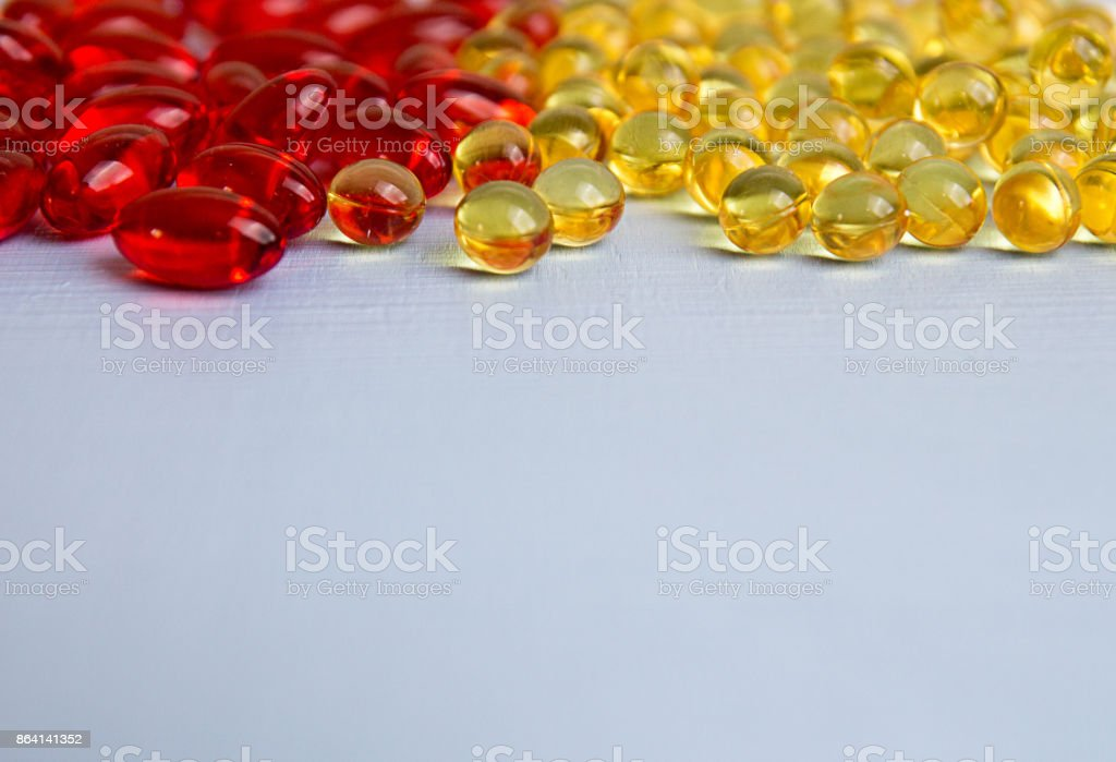 Pills background. Heap of assorted various medicine tablets and pills in blisters different colors on blue background. Healthcare or medicament addiction concept. Copy space. royalty-free stock photo