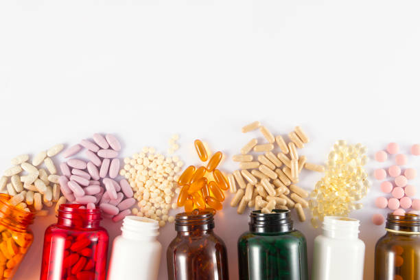 pills background - vitamin stock pictures, royalty-free photos & images