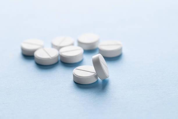 pills arka plan - tablet stok fotoğraflar ve resimler