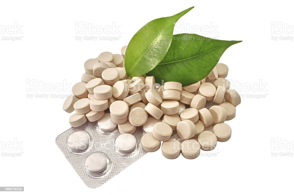 Pills Bio tablets Medicine with green leaf royalty-free stock photo