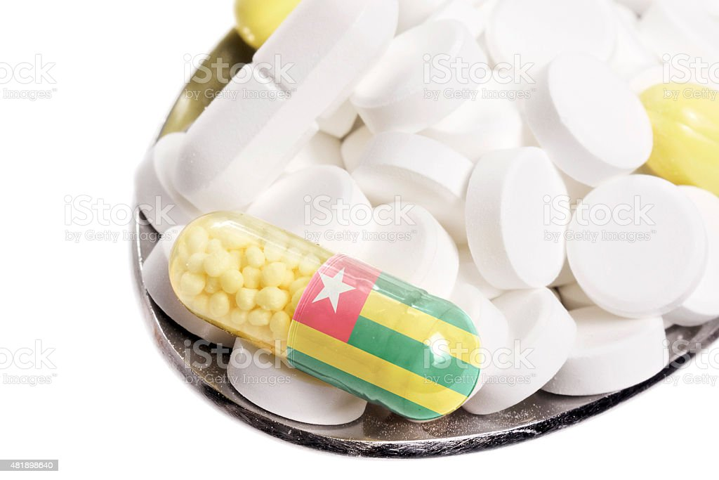 Pills & capsule with the flag of Togo.(series) stock photo