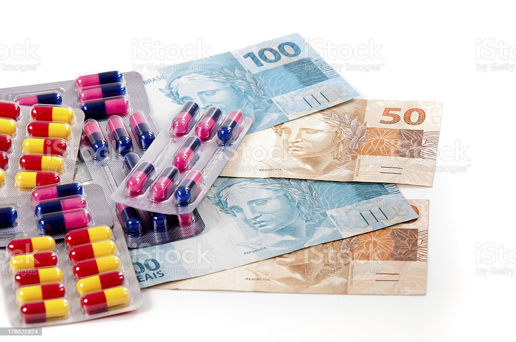 Pills ,capsules and brazilian currency royalty-free stock photo
