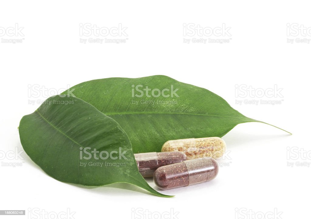 Pills Capsules Bio and green leaf natural isolated royalty-free stock photo