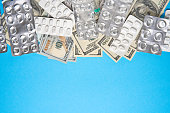 istock pills empty blisters for drugs individual syringe and money lie on a blue background 1244090154