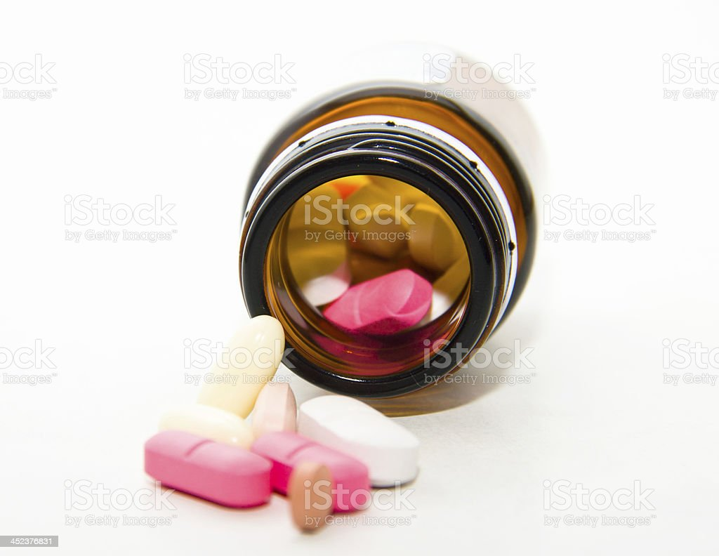 pills fallen out of the box stock photo