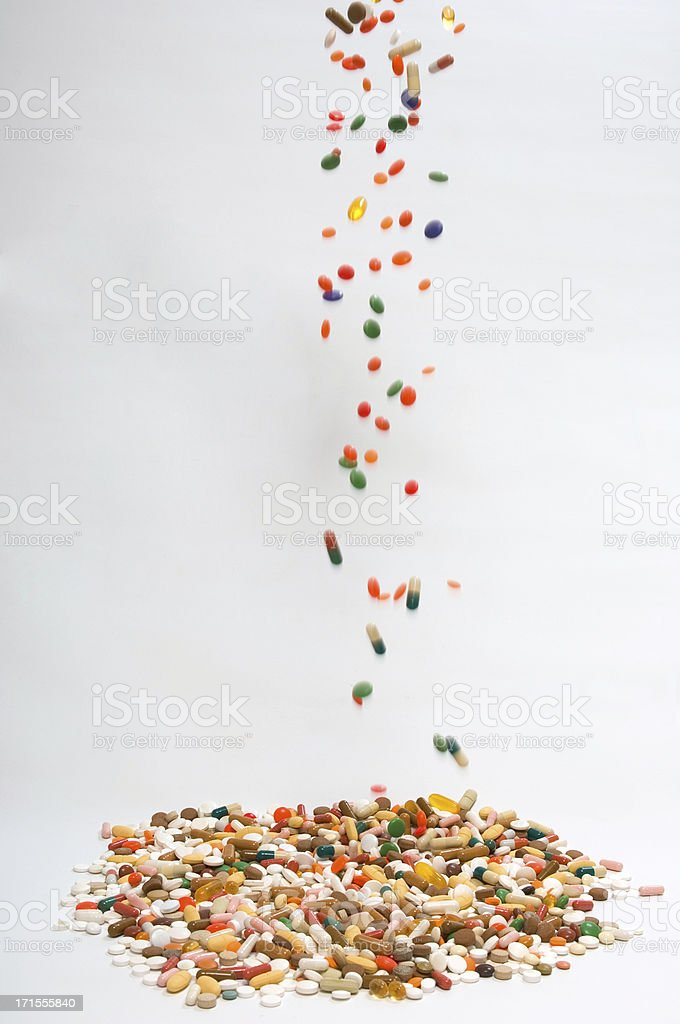 pills falling down stock photo