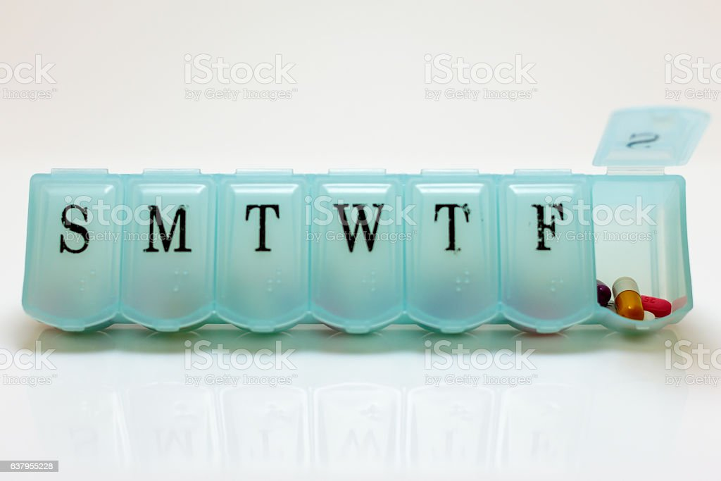 Pills for Saturday stock photo