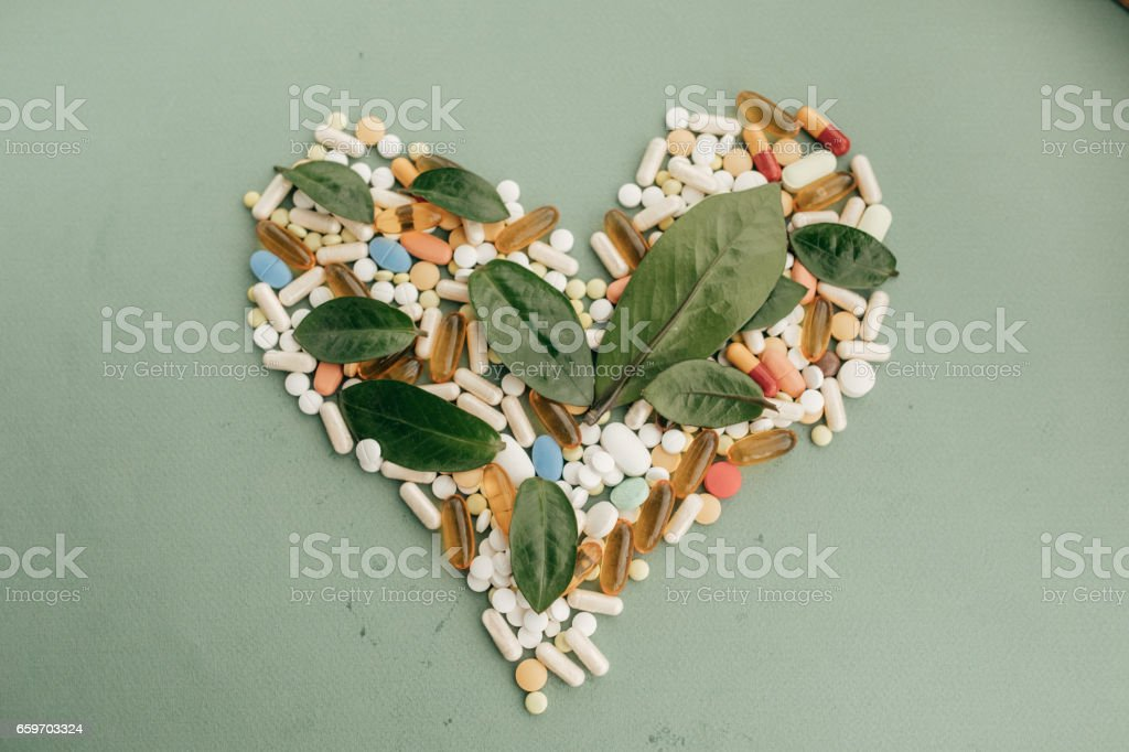 Pills forming heart shape stock photo