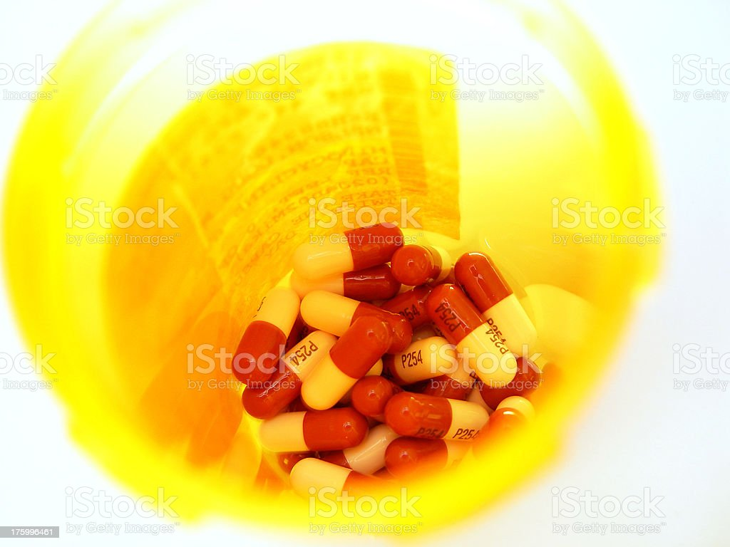 Pills in a pillbottle stock photo