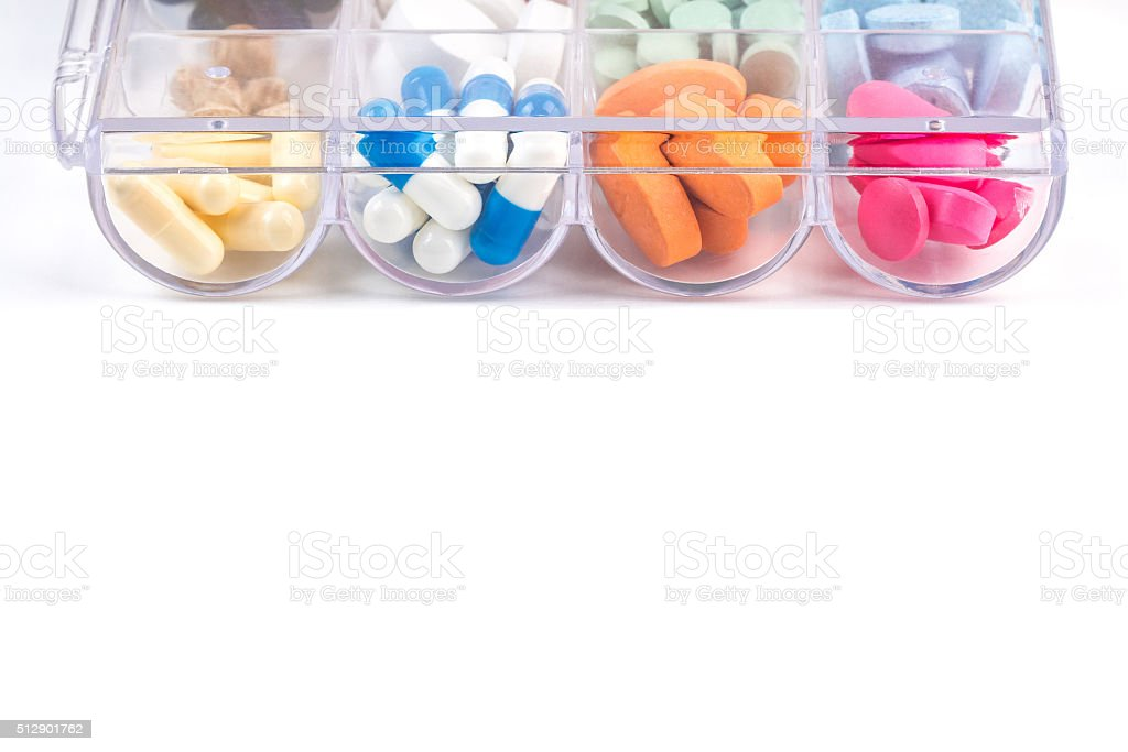 Pills in plastic container on white stock photo