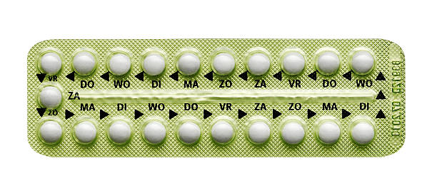 pills in strip - birth control pill stock photos and pictures