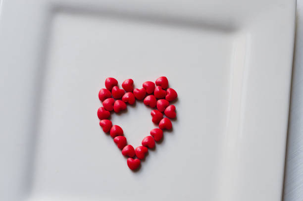 Pills in the shape of heart stock photo
