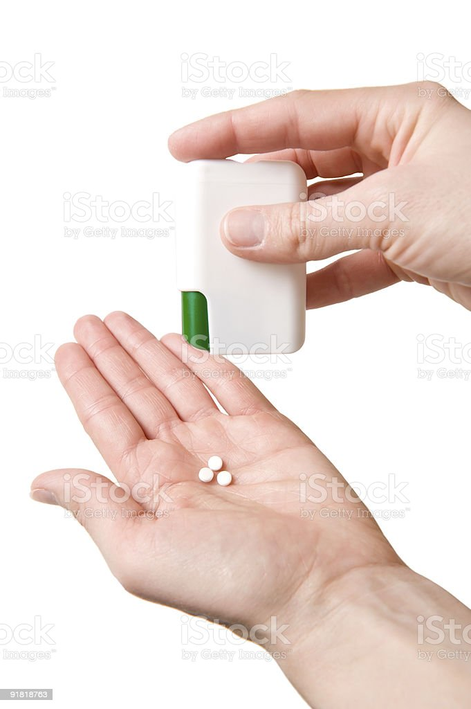 Pills in the woman hands - Isolated on White royalty-free stock photo