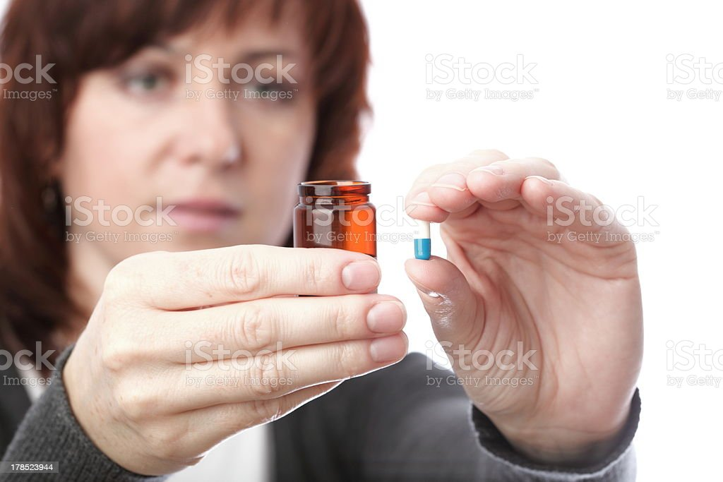 Pills in woman hand royalty-free stock photo
