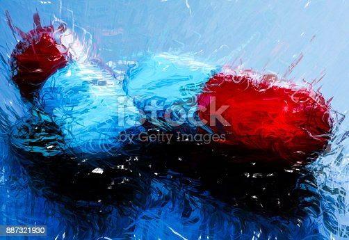 A digitally generated illustration of Pills medicine capsules blue and red
