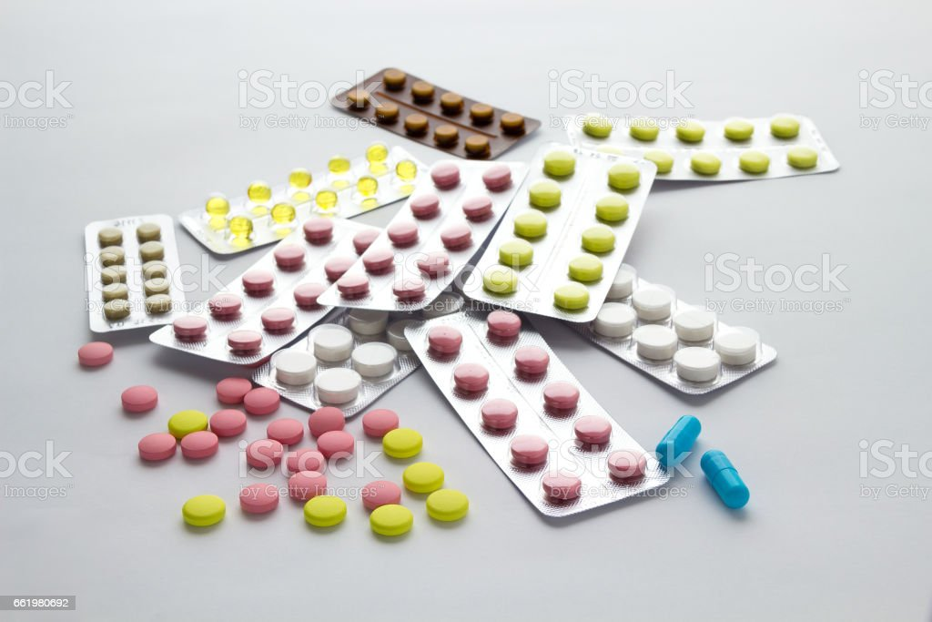Pills of different colors on a light background royalty-free stock photo