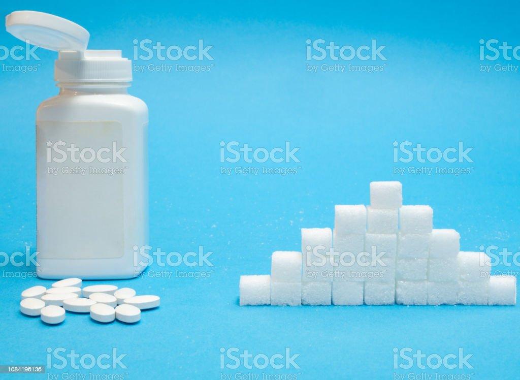 pills of sugar substitute vs normal sugar stock photo