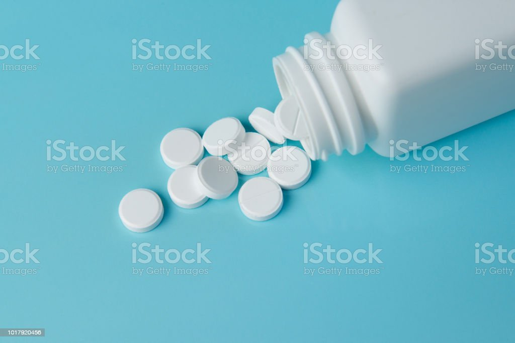 Pills on a blue background. stock photo