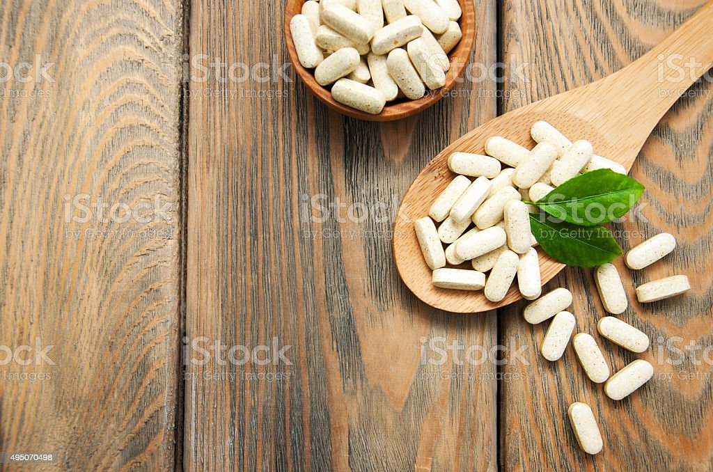 pills on spoon stock photo