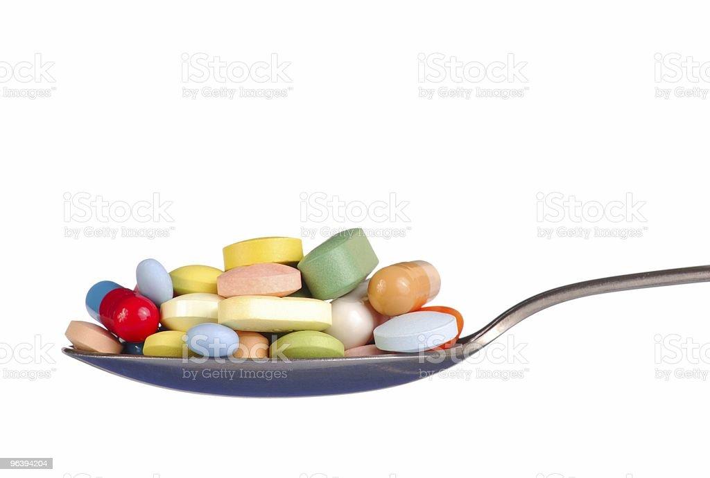 Pills on Teaspoon royalty-free stock photo