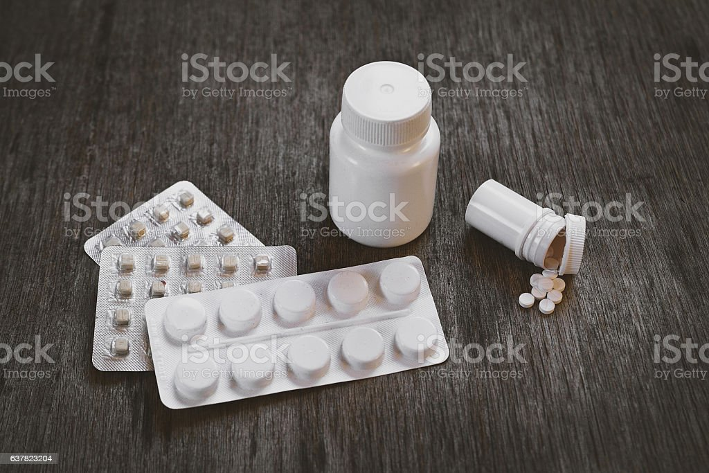 Pills on the Table at the Home closeup stock photo