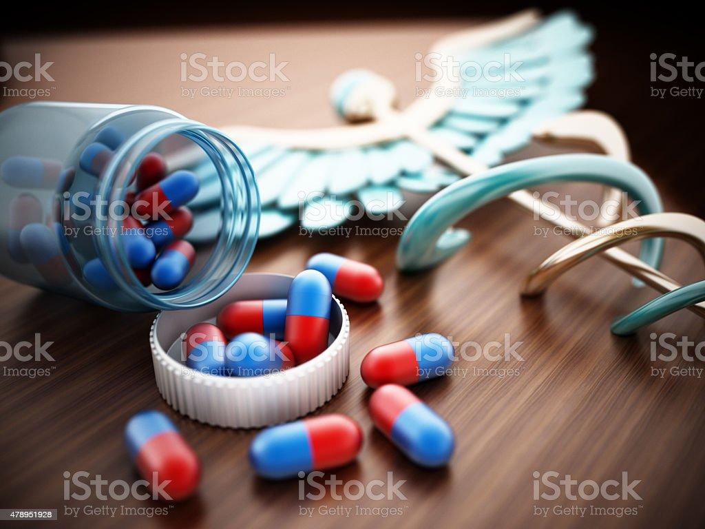 Pills on wooden table stock photo