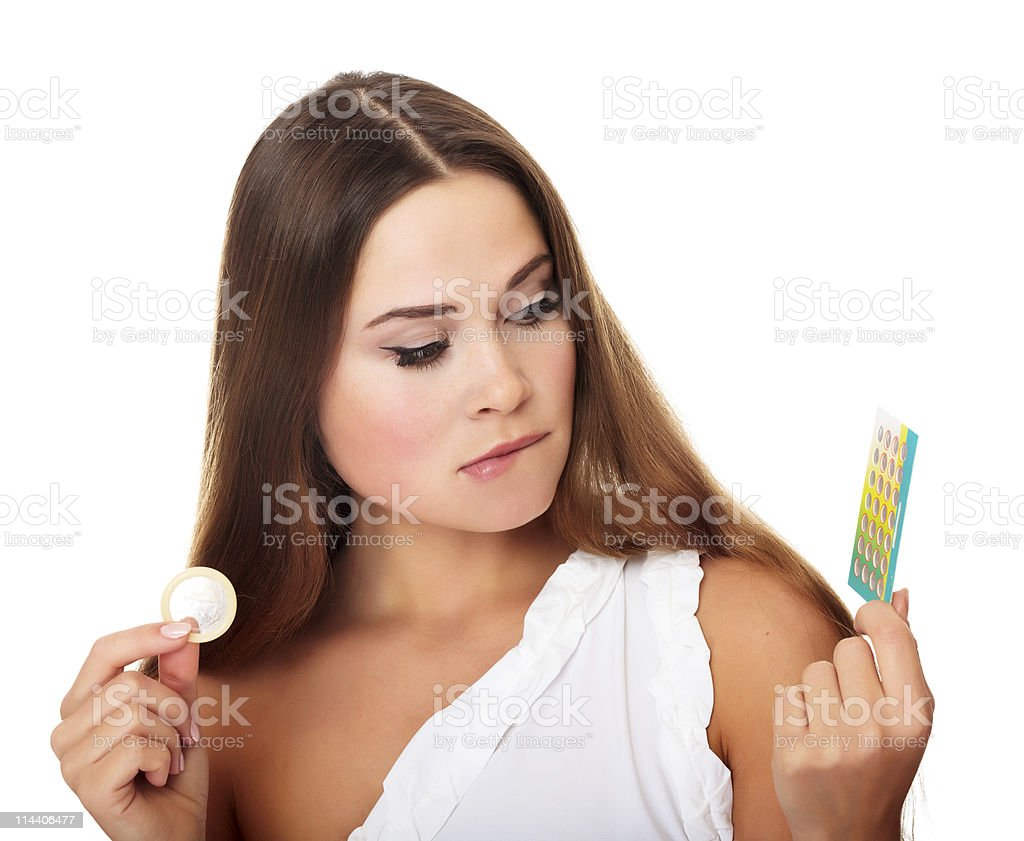 Pills or a condom? stock photo