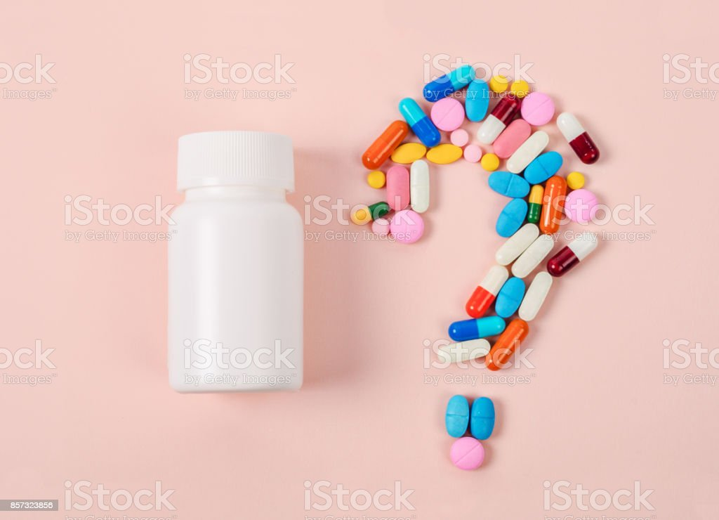 Pills or capsules as a question mark stock photo