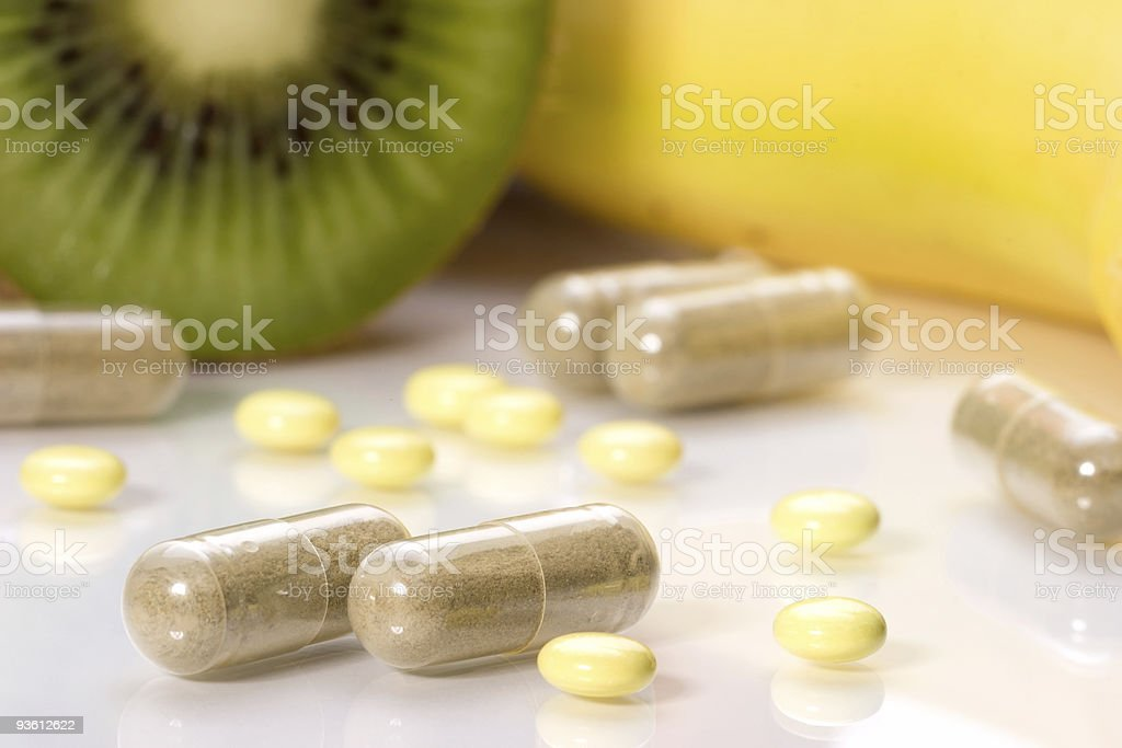 Pills or fruits royalty-free stock photo