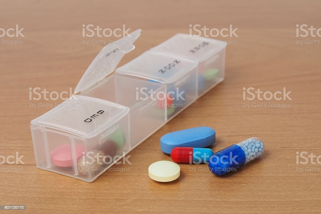 Pills organizer on a table stock photo