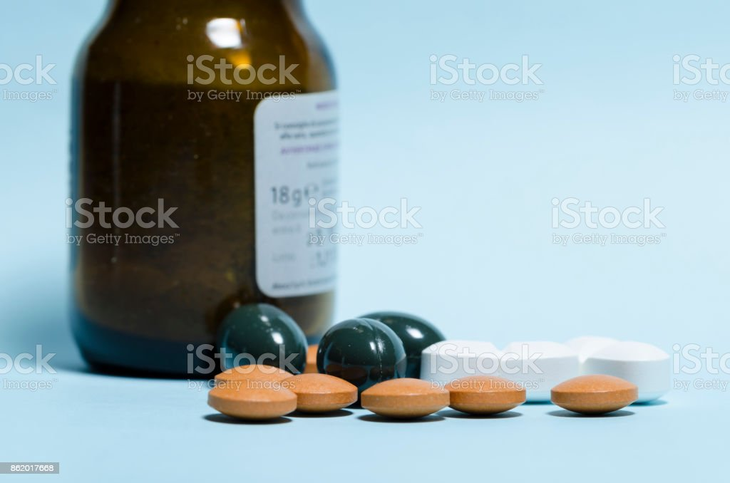 pills over blue table stock photo