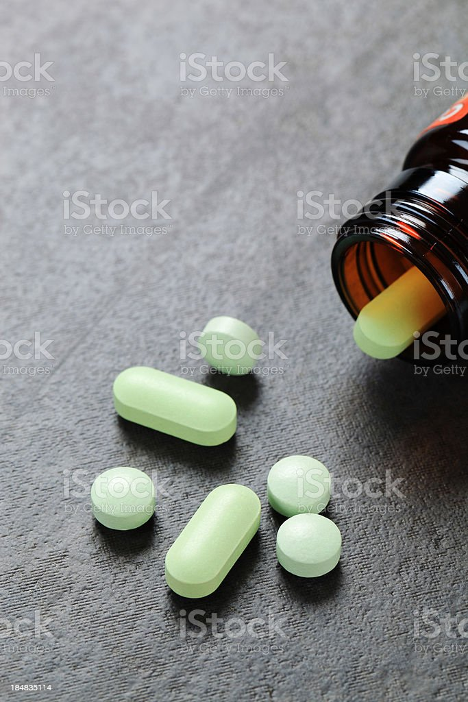 Pills pouring out of a bottle royalty-free stock photo