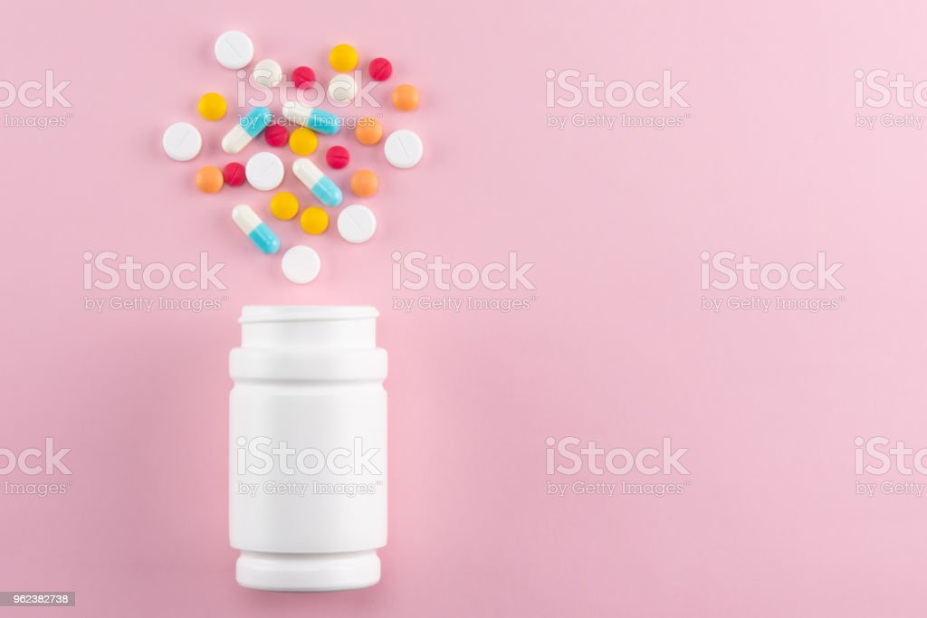 pills pouring out of the medcine bottle with copy space stock photo