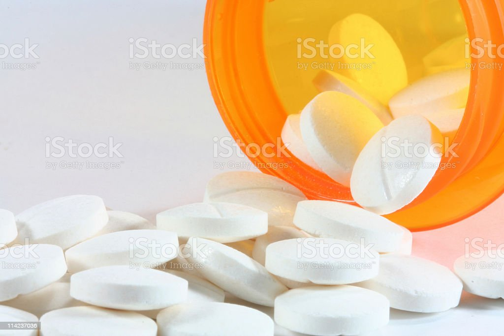 Pills Spilling Out of a Bottle royalty-free stock photo