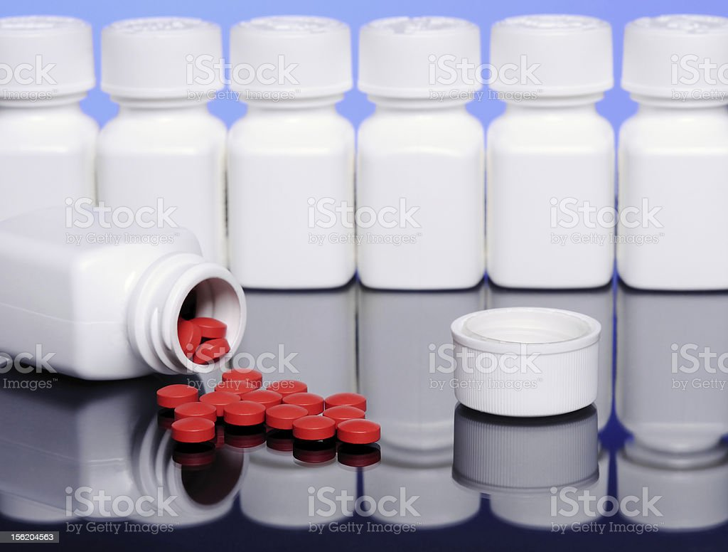 Pills Spilling with Reflection royalty-free stock photo