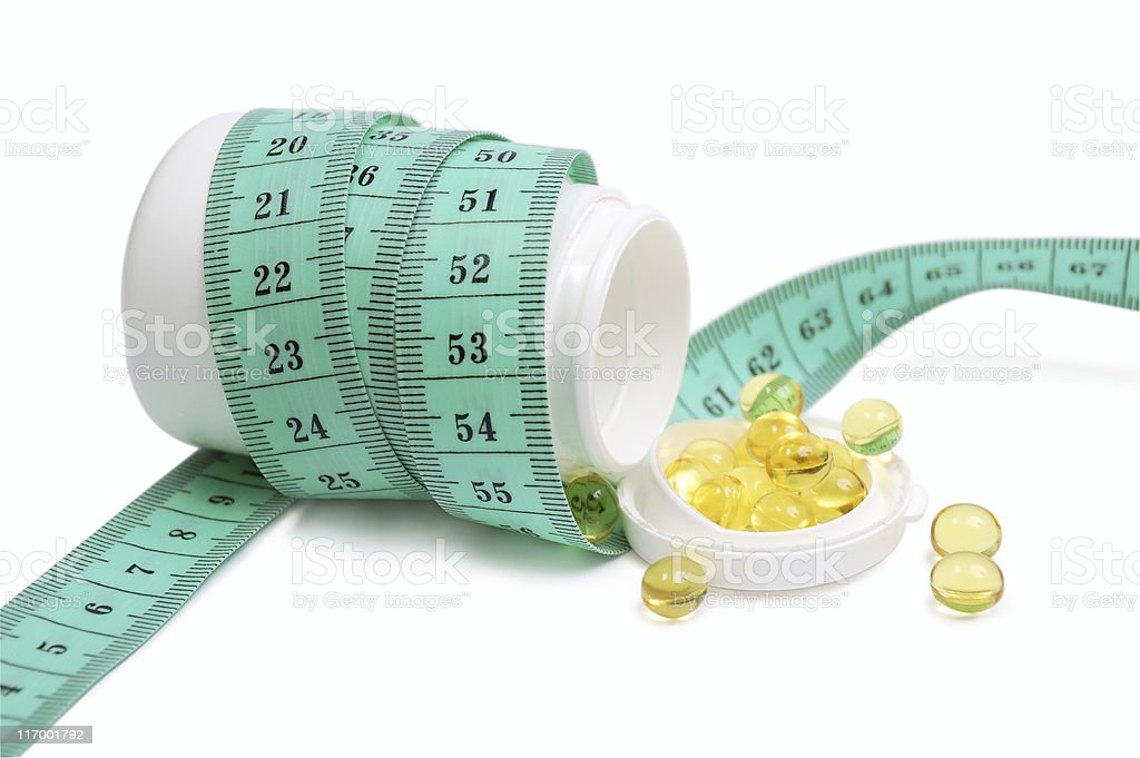 Pills strewed from a jar royalty-free stock photo