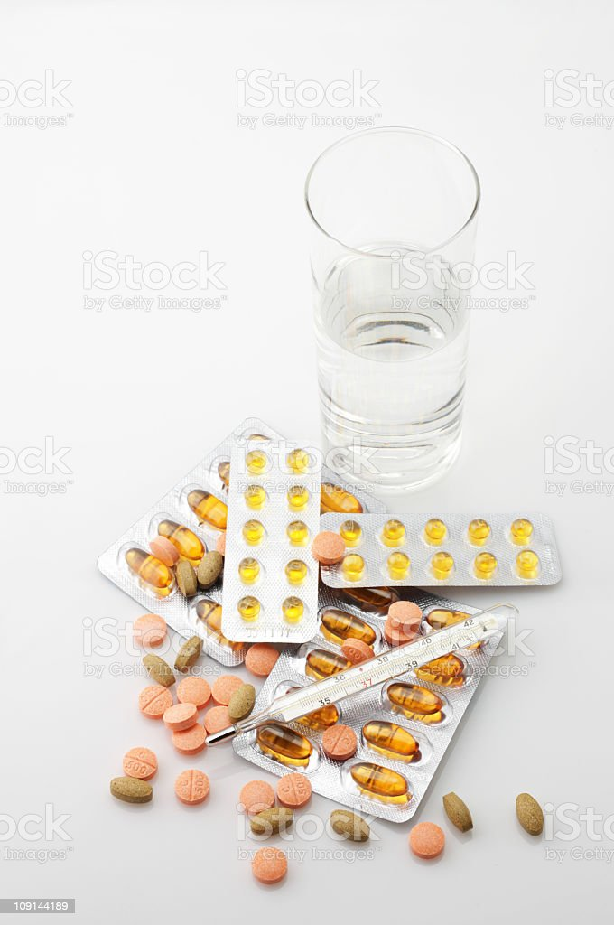Pills, thermometer and water royalty-free stock photo