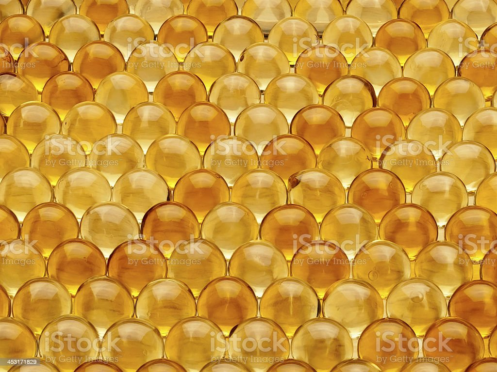 Pills with cod-liver oil royalty-free stock photo
