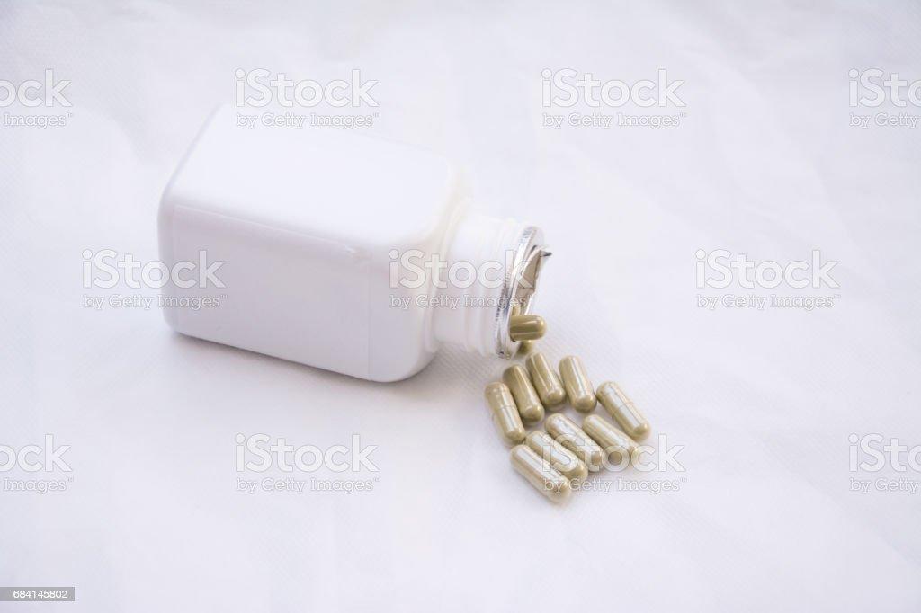pills with medicine pill bottle close-up on a white background zbiór zdjęć royalty-free