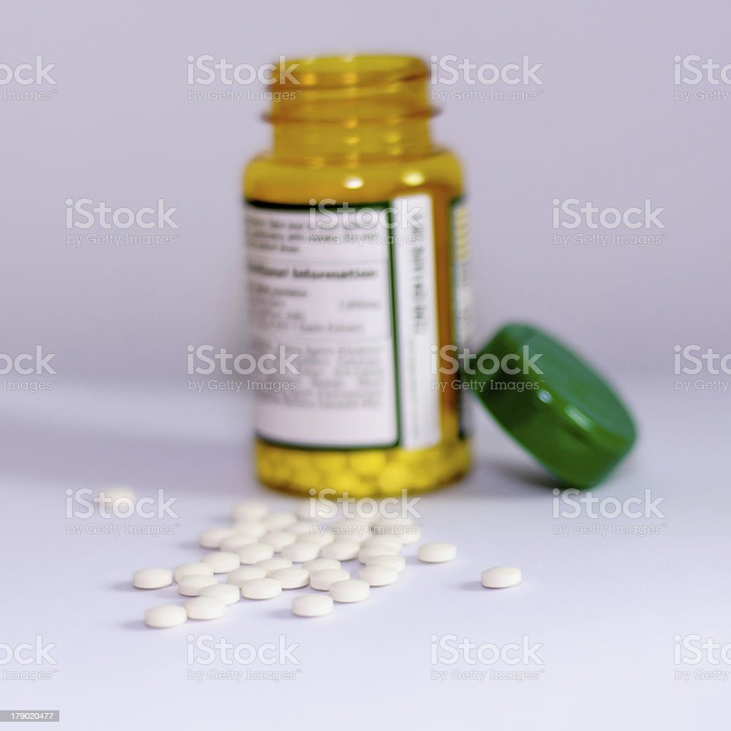 Pills with vertical bottle royalty-free stock photo