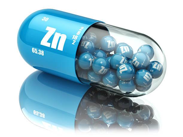 pills with zinc zn element dietary supplements. vitamin capsules - 鋅 個照片及圖片檔