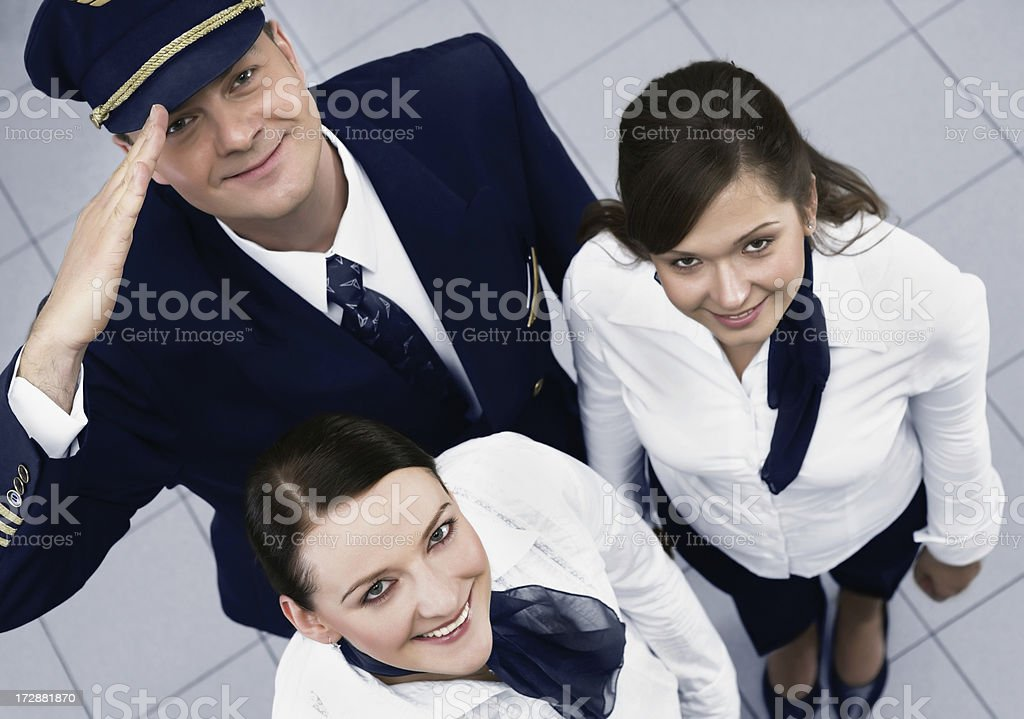 Pilot and a stewardess showing success stock photo