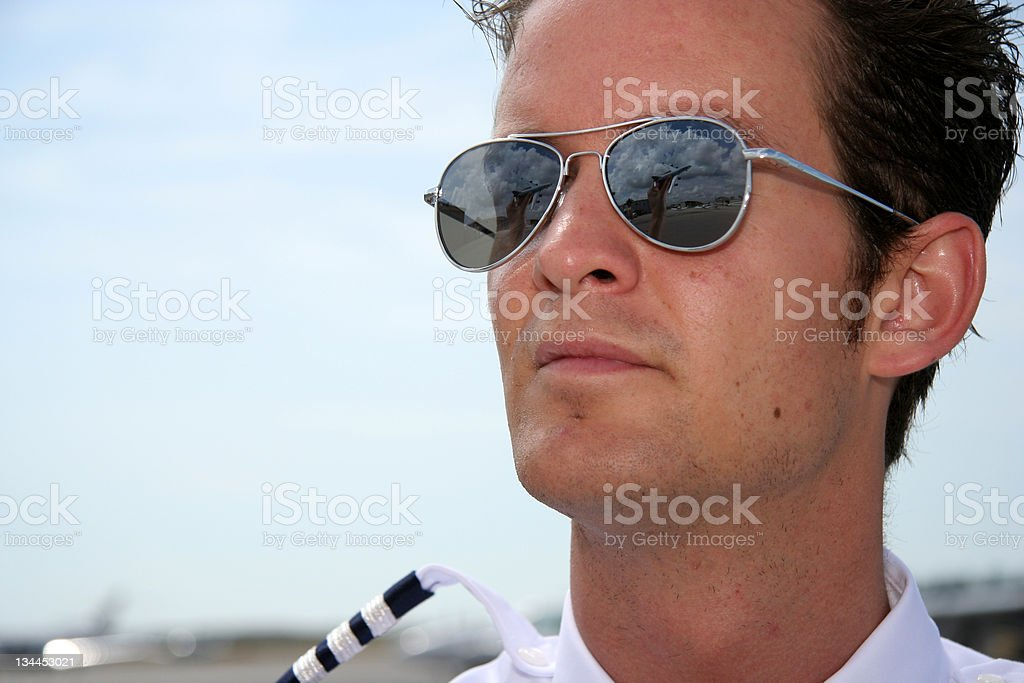 Pilot and airplane reflection royalty-free stock photo