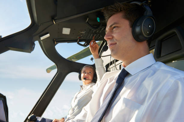 Pilot And Co Pilot In Cockpit Of Helicopter stock photo