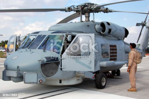 istock Pilot approaching navy helicopter 92647683