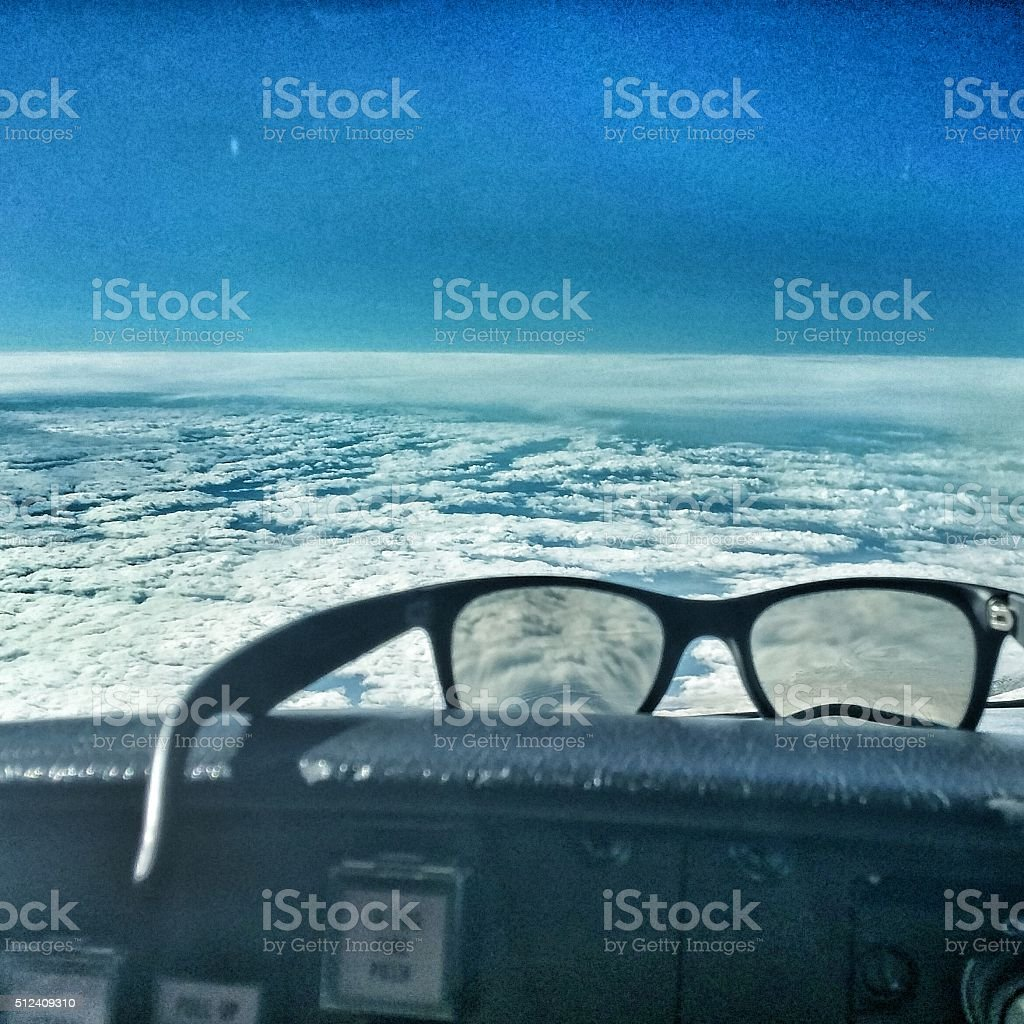 Pilot Avaition Sunglasses Resting on Airplane Cockpit Flight Deck Dashboard stock photo