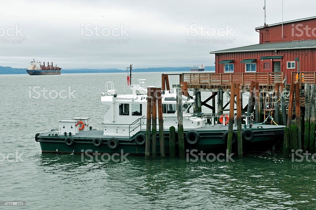 Pilot boat and freighters in mouth Columbia river royalty-free stock photo