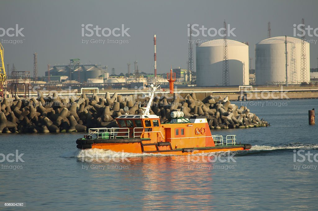 Pilot boat crashing through the waves leaving the port stock photo