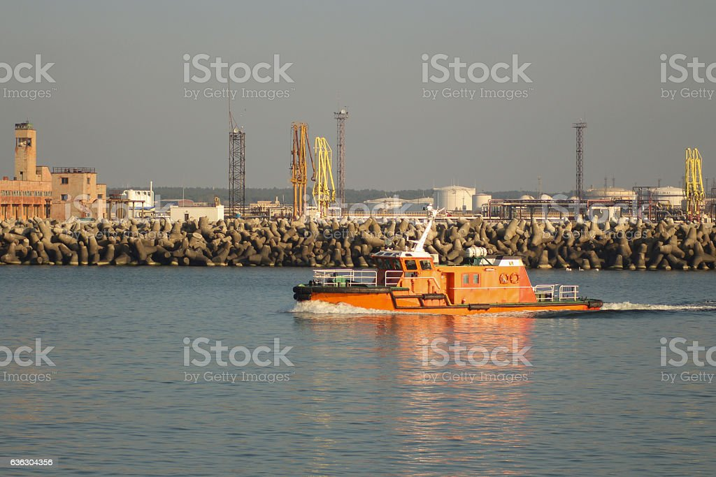 Pilot boat leaving the port in beautiful weather stock photo