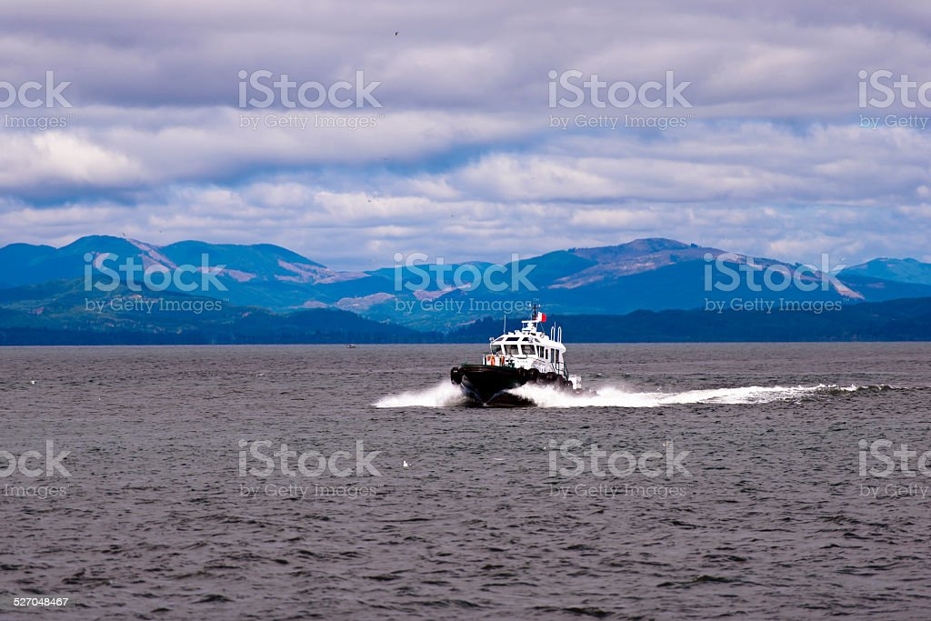 Pilot boat on waves at mouth of Columbia River stock photo